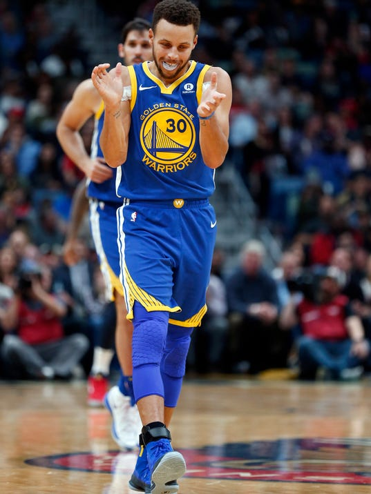 Golden State Warriors guard Stephen Curry (30) reacts after hitting a three-point basket in the second half of an NBA basketball game against the New Orleans Pelicans in New Orleans, Monday, Dec. 4, 2017. (AP Photo/Gerald Herbert)