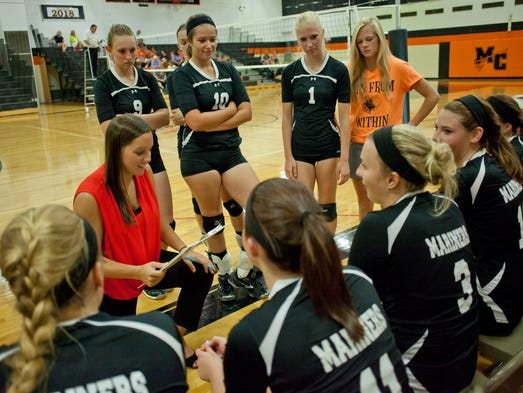Marine City coach Kelly Thomas talks with players on the sidelines during a volleyball match against Algonac Tuesday, Aug. 26, 2014 at Marine City High School.
