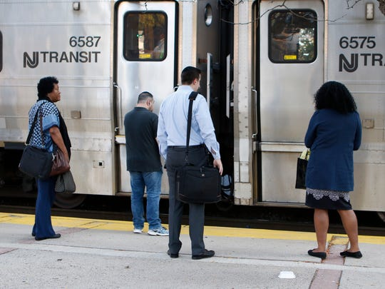 Commuters on the platform at the MTA-Metro-North train station in Spring Valley board a train for Hoboken on Monday, July 10, 2017.