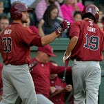 In this April 21, 2015 photo, USC first baseman Kyle Martin (33) celebrates with center fielder Gene Cone (19) after Cone scored the Gamecocks first run of the game against Furman. Cone was named the SEC Player of the Week on Monday.