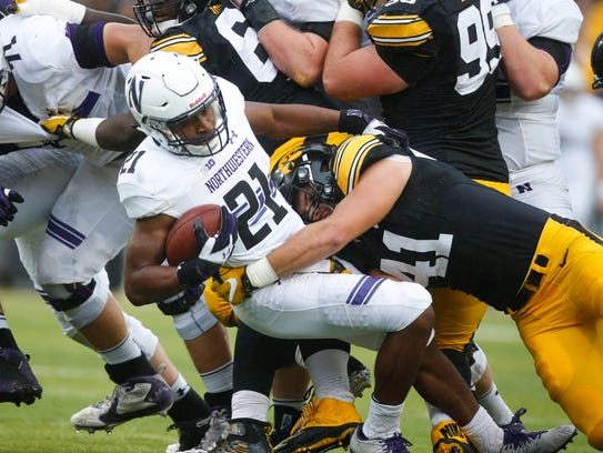 Iowa linebacker Bo Bower hits Northwestern running