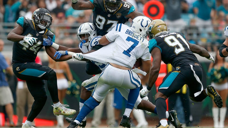 e5cd82c9b97 Indianapolis Colts quarterback Jacoby Brissett (7) is surrounded by Jacksonville  Jaguars outside lin…