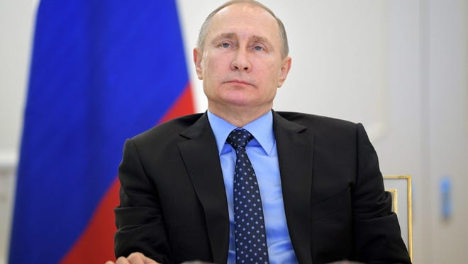 Russian President Vladimir Putin watches a ceremony to launch natural gas supplies to Crimea from mainland Russia via a new gas pipeline connecting the Krasnodar Territory with the Crimea peninsula during a live video link in Moscow on Tuesday.