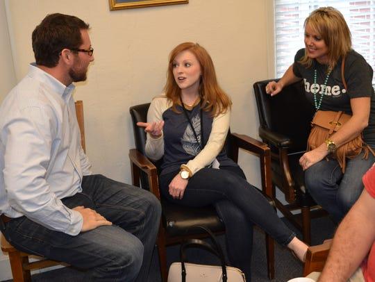 Ellie Wright, center, and Jennifer Pinkston greet Garrick