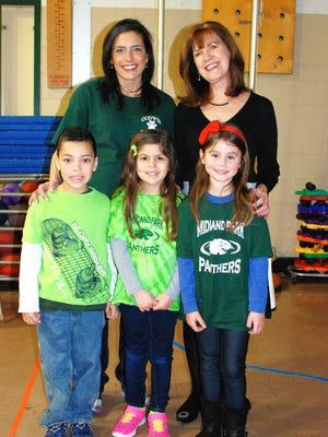 Aidan, Emily and Melanie welcome Godwin School's new interim principal Patricia Hart, who will be filling in for Danielle Bache.