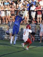 Xavier Johnson of Summit pulls down a touchdown pass