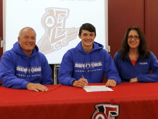 Ben Cardamone III with his parents, Ben and Lauri Cardamone, at Wednesday's signing ceremony at Elmira High School.