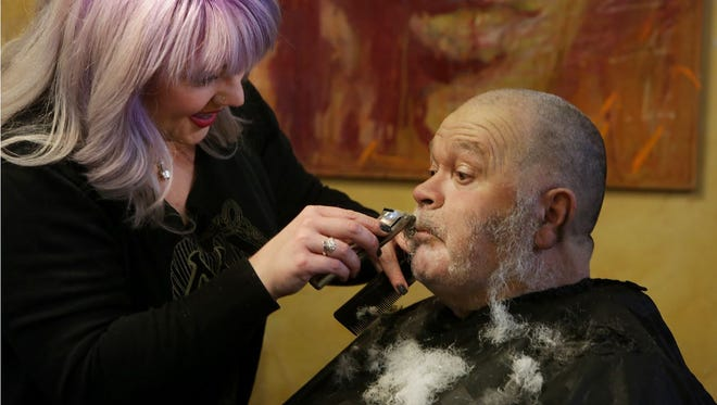 Stylists at Mojo Pie Spa and Salon treated area homeless to haircuts