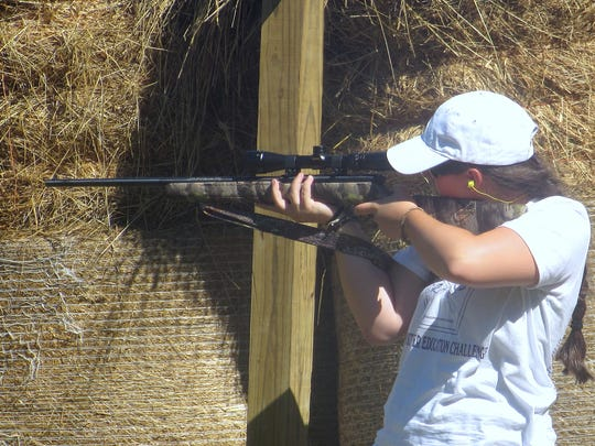 A youth shooter zeroes in on the target with a .22-caliber