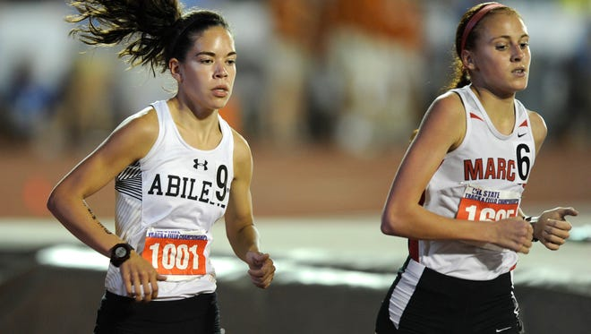 Abilene High's Ashton Endsley (left) runs the turn in the Class 6A girls 1600-meter run at the UIL Track and Field State Championships on Saturday, May 16, 2015, at Mike A. Myers Stadium in Austin.