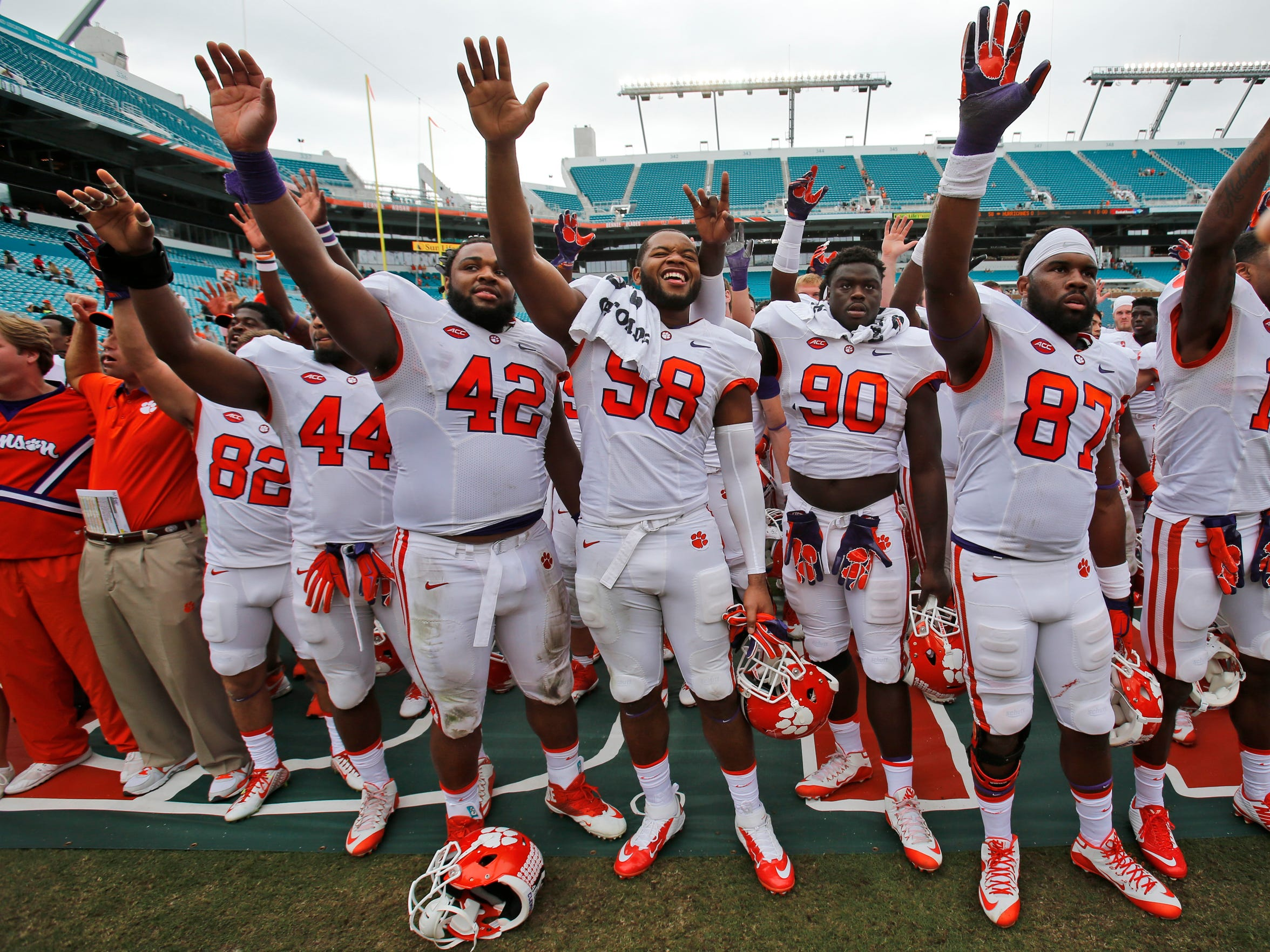 Clemson players celebrate after their 58-0 win over Miami in a game on Saturday.