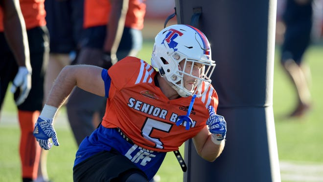 North squad wide receiver Trent Taylor of Louisiana Tech (5) runs around a blocking dummy during practice at Ladd-Peebles Stadium.