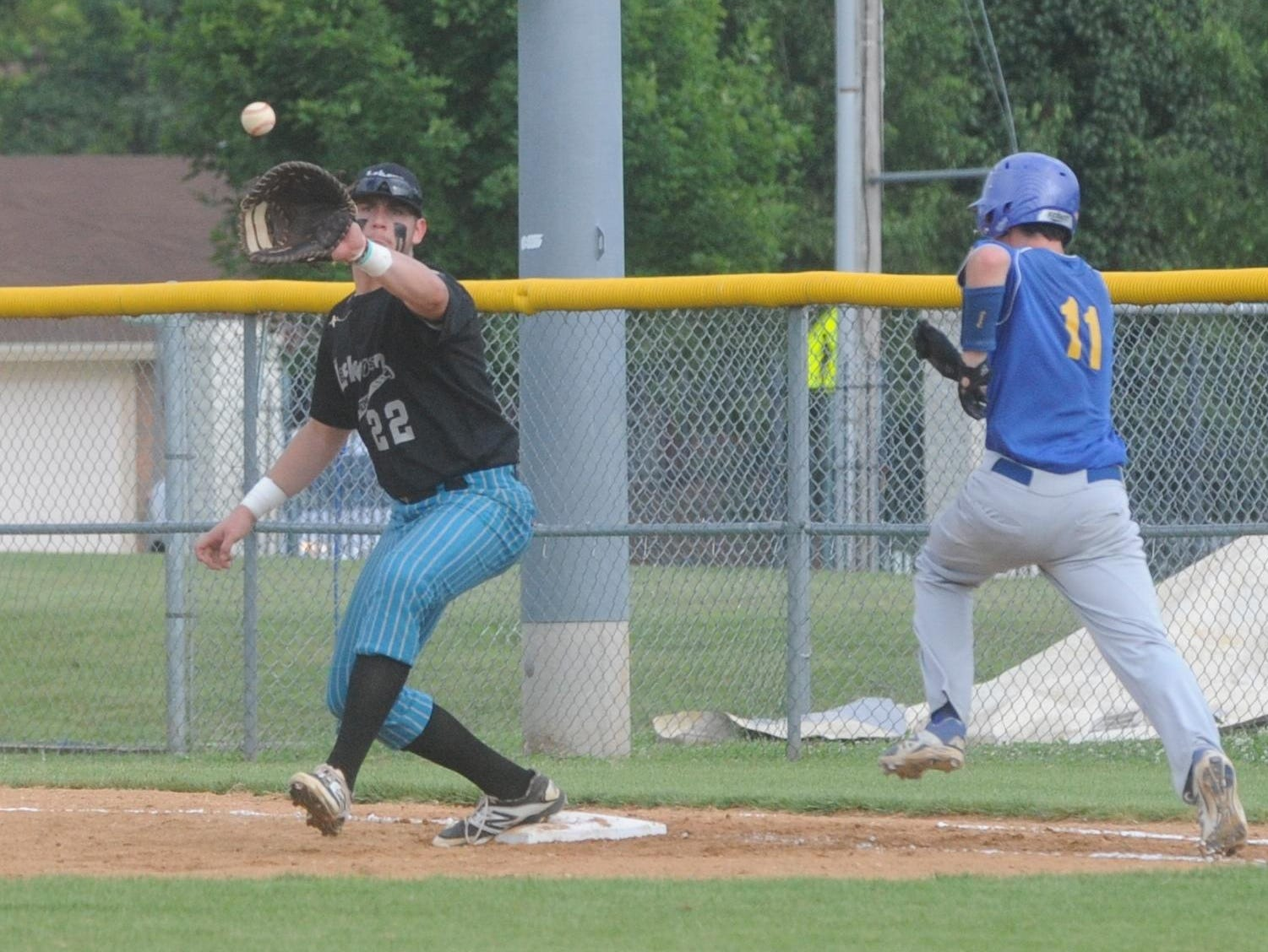 Lockeroom first baseman Sky-Lar Culver receives a throw to force out a Harrison batter during recent action at Cooper Park. Lockeroom swept a Zone 2 doubleheader from the Blytheville Casons on Saturday at Blytheville.