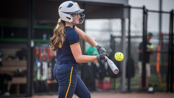 Delta's Reagan Jones hits against Yorktown during their game at the Yorktown Sports Park Wednesday, April 20, 2016.  Jones has been the starting catcher for Delta all four years in high school.