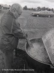 Robert Baye makes a batch of booyah in this undated photo.