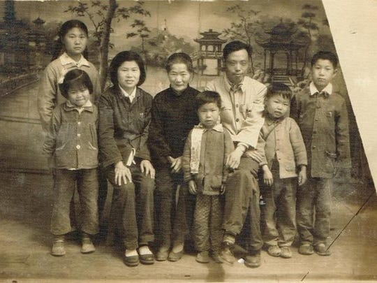 Family photo dated 1961. Zhang's mother is third from