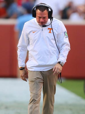 Tennessee coach Butch Jones.walks on the sideline during his team's game against Georgia.