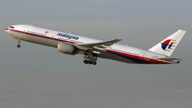 In this Nov. 15, 2012 photo, the Malaysia Airlines Boeing 777-200 with tail number 9M-MRD _ the same aircraft that was shot down near the Ukraine Russia border on Thursday, July 17, 2014 _ takes off from Los Angeles International Airport. Ukraine said the passenger plane was shot down Thursday as it flew over the country, and both the government and the pro-Russia separatists fighting in the region denied any responsibility for downing the plane.