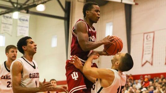 Indiana's Yogi Ferrell drives to the basket against players from Carleton University in Ottawa, Canada, Monday August 11, 2014.