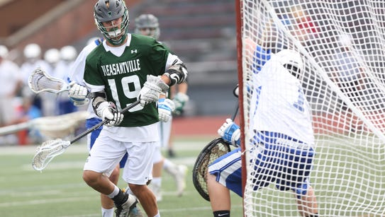 Pleasantville's Ryan Drillock (19) gets a shot by Rondout