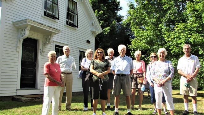 John Carroll, center, hosts friends, neighbors and the Bourne Society for Historical Preservation at his Barlows Landing house, which was afforded a plaque of preservation distinction.