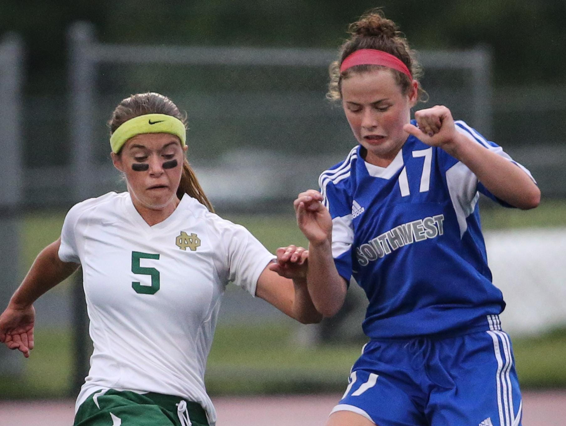 Mikayla Ross of Oshkosh North and Alexis Cumber of Green Bay Southwest go for the ball in Thursday's WIAA Divsion 2 sectional semifinal.
