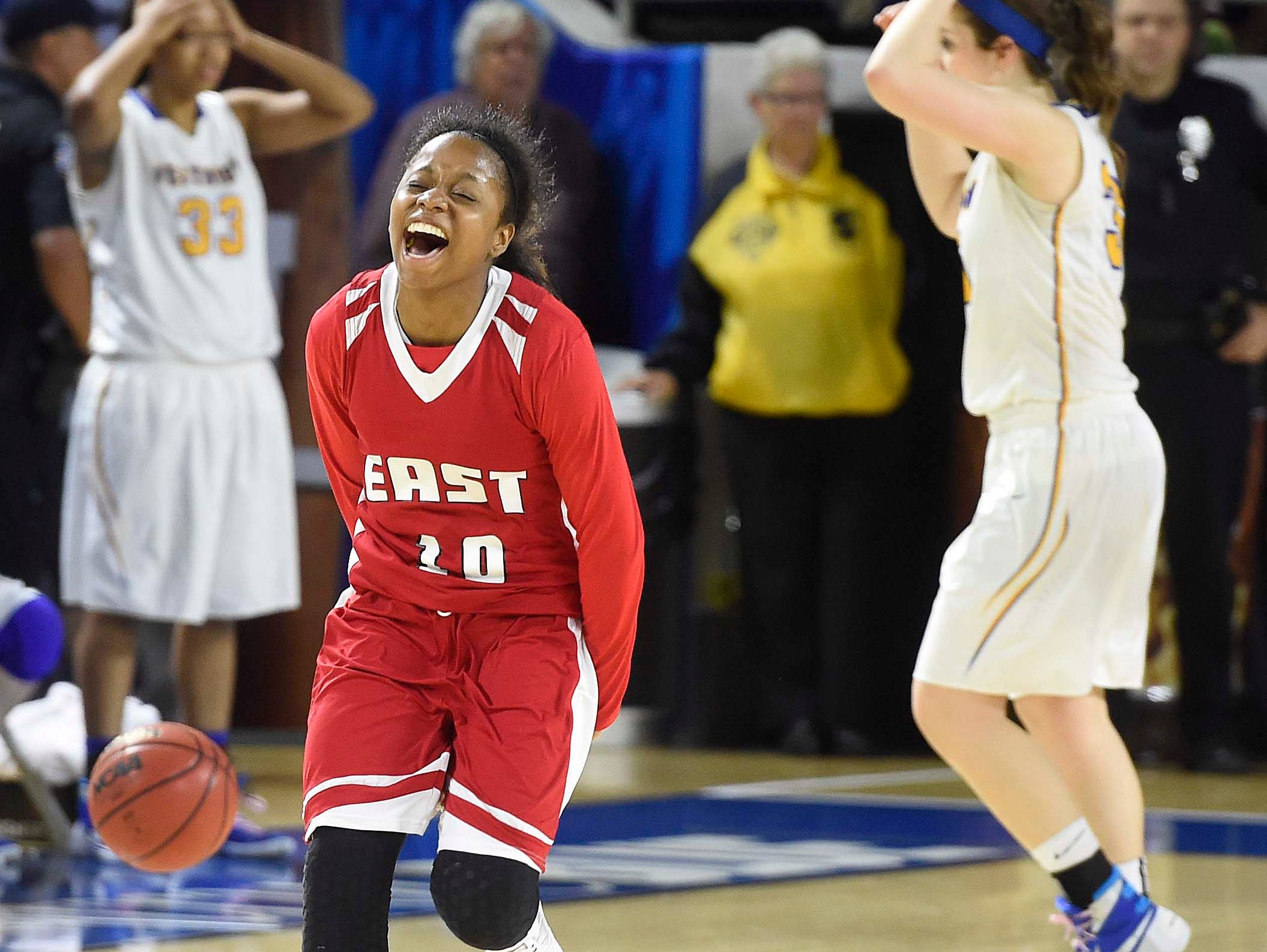 East's Le'Jzae Davidson (10) celebrates as East makes a huge run at the end to win over Westview High School 35-32 in the Division I Class AA Girl's basketball semi-finals at the Murphy Center on MTSU's campus March 11, 2016 in Murfreesboro, Tenn.