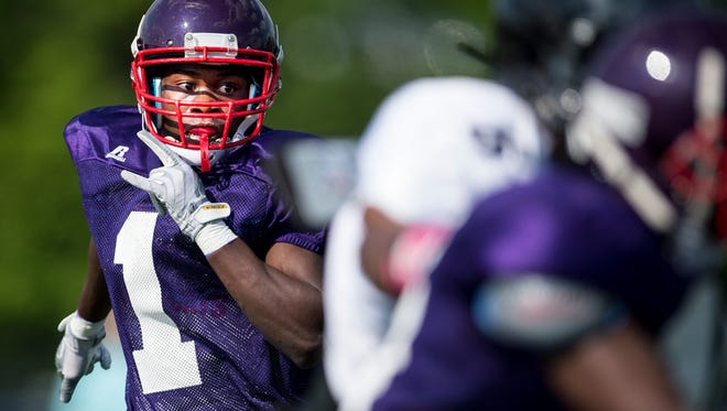 Father Ryan's Elton Nkwembe maneuvers against Cane Ridge players during a scrimmage Friday.