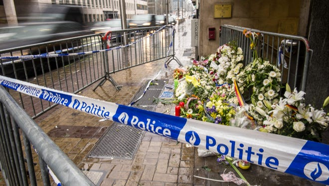 A photo taken on March 25, 2016, shows wreaths of flowers in front of an entrance of the Maelbeek subway station in Brussels in homage to the victims of a terrorist attack.
