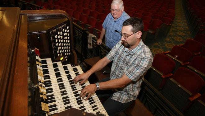 David Schroth, Jr. plays a Pilcher organ as Timothy Baker looks on ahead of an upcoming performance at the Memorial Auditorium.  Schroth is the project coordinator and Baker is the president of the Bauer Foundation and organist.Oct. 24, 2016