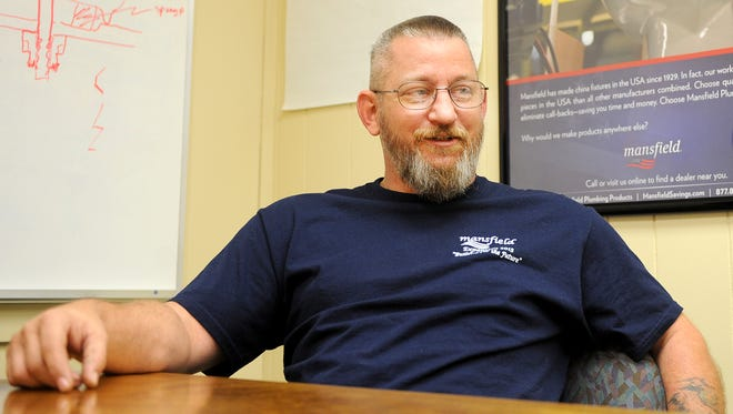 Ron Mckinley talks about his 23 years of service in the Navy. Mansfield Plumbing has 49 employees who have more than 300 years of combined military service.