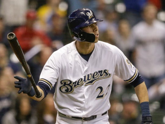 Christian Yelich of the Brewers watches his game-tying