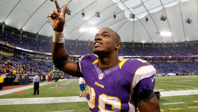 Minnesota Vikings running back Adrian Peterson celebrates after an NFL football game against the Detroit Lions on Nov. 11, 2012, in Minneapolis. Peterson could find himself in a Cardinals jersey this fall.