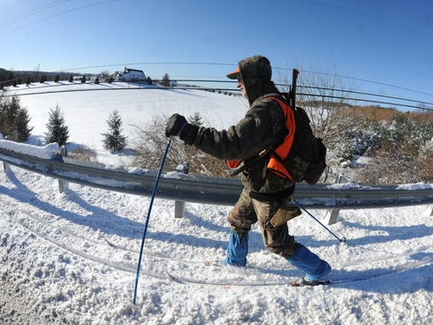 Stephen Swope uses skis to travel along Trinity Road in York, Pa., on Jan. 3.