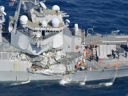 The damage of the right side of the USS Fitzgerald is seen off Shimoda, Shizuoka prefecture, Japan, after the Navy destroyer collided with a merchant ship, Saturday, June 16, 2017. The U.S. Navy says the USS Fitzgerald suffered damage below the water line on its starboard side after it collided with a Philippine-flagged merchant ship.