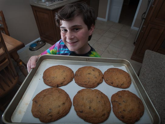 Spencer Levy poses next to his cookies at his home