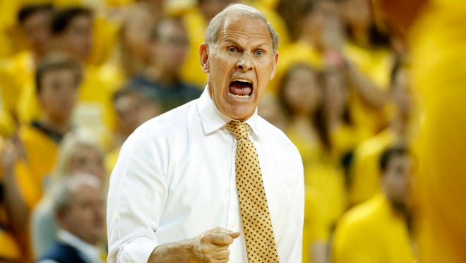 """""""I got to trust the officiating crew made the right call but it's still one that will be right along, to me, like who shot JFK. I don't know if we'll ever know the real answer,"""" says Michigan coach John Beilein about the overturned call."""