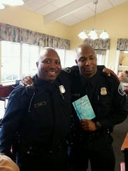Detroit Police Officer Glenn Doss Sr., left, poses