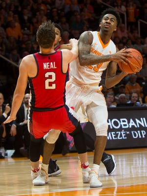 Tennessee's Jordan Bowden, right, drives past Ole Miss' Cullen Neal during Wednesday's game at Thompson-Boling Arena. Tennessee defeated Ole Miss 75-66.