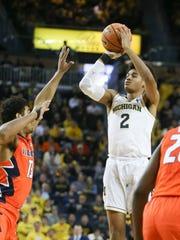 Michigan guard Jordan Poole scores against Illinois