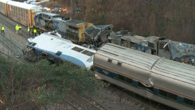 In this image from video, train cars are smashed and derailed Feb. 4, 2018 near Cayce. S.C. The crash left multiple people dead and dozens of people injured.