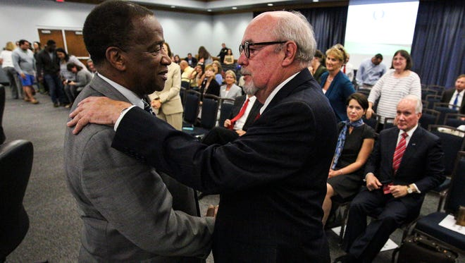 Current FGCU President Wilson Bradshaw congratulates Michael Martin on becoming the new FGCU President. The Florida Gulf Coast University Board of Trustees voted to 12 to 0 to name Michael Martin, former chancellor at Louisiana State University, as the new president at Florida Gulf Coast University.