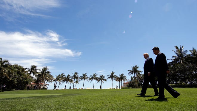President Trump and Chinese President Xi Jinping walk together after their meetings at Mar-a-Lago