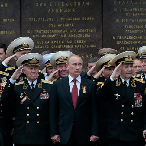 Russian President Vladimir Putin, shown at a Victory Day parade in Sevastopol, Crimea, on  May 9,  reportedly told the EU president he could be in Kiev in two weeks, if he wanted.  A Kremlin aide said on Sept. 2 that the quote was taken out of context.