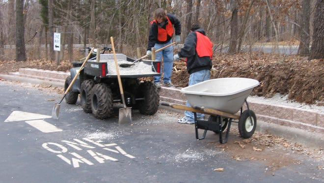 Workers in the CASP program lay down gravel at the Springfield Conservation Nature Center.