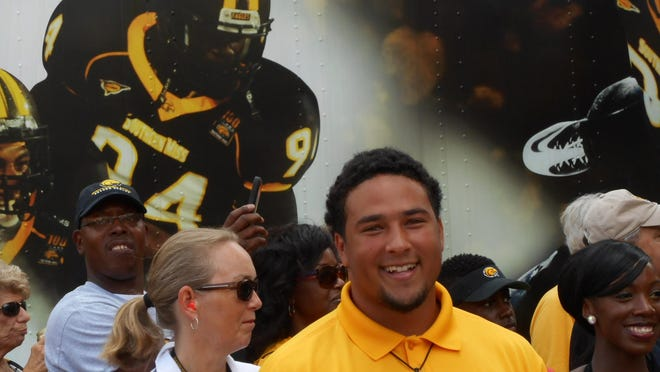 Southern Miss football player Collin Kilcrease takes part in Eagle Walk.