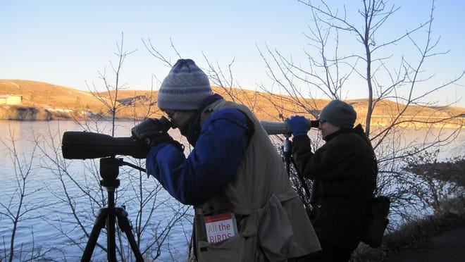 Nora Gray, left, and Beth Hill use spotting scopes in 2012 at Giant Springs during the annual Christmas Bird Count.