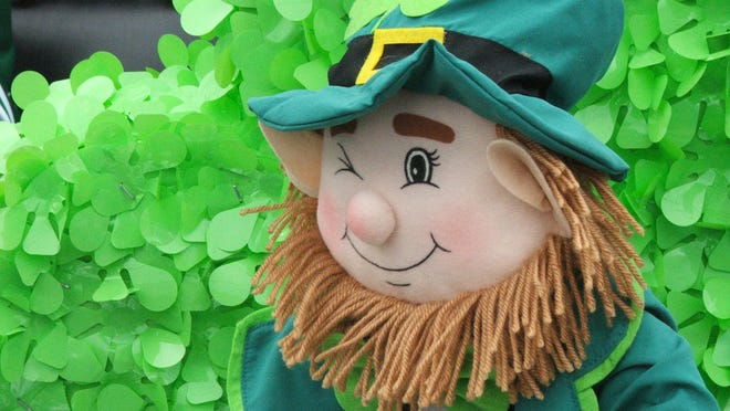 A leprechaun figurine winks as part of a float participating in the 46th annual Irish Day Parade.