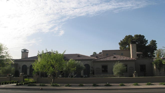 Nick Hoss and his wife, Helen Kazemi, paid $2.725 million for this 2,106-square-foot house at El Norte Cuarenta in Paradise Valley. The sale closed during the week of February, 24, 2014.