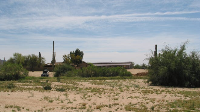 Bassam Alsaqran paid $1.7 million for this working ranch and former home of Apache Peak Equestrian Center, which includes a 2,480 square-foot home, corrals, stables and barn on nearly nine acres south of the Whisper Rock Golf Club in Scottsdale.